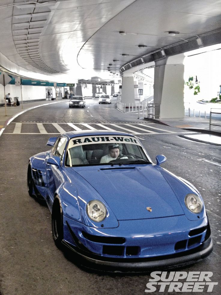 "1995 PORSCHE 911 993 ""C2"" CARRERA RWB (Rauh-Welt Begriff, German for ""rough world concept"", Japan). The only branch outside Japan is RWB-USA... The wide body kit starts at US$18,000. There are around 100+ RWB cars in Japan and 6 in the USA."