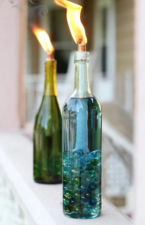 Keep bugs at bay while you relax outside with these wine bottle citronella candles.