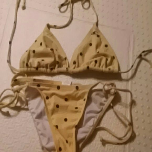 O'Neill yrllow/navy polka dot bikini O'Neill yellow with navy polka dots bikini set. bottoms are small, top says large but it fit me when I wore a 32A bra. Bottoms come up high, and they showed more of my rump than I liked! Bottoms worn once, top worn a few times. O'Neill Swim Bikinis