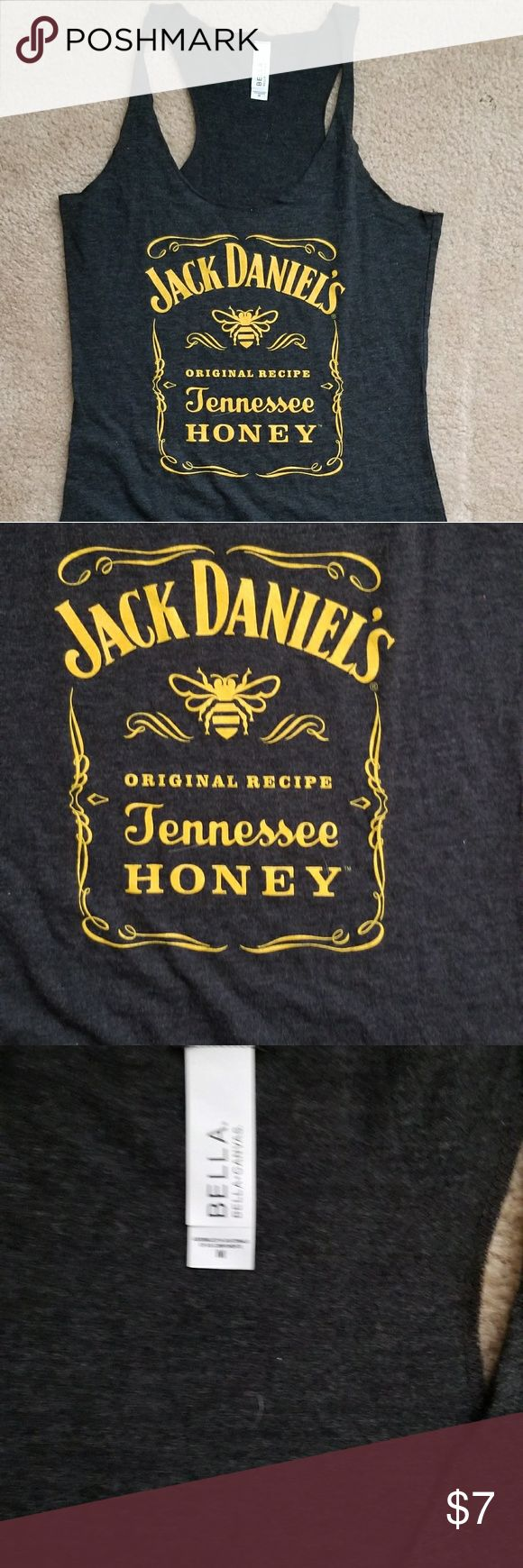 🚫SOLD🚫 Jack Daniels T-Shirt Jack Daniels T-Shirt Size Medium  Color - Gray with Gold Lettering  Gently Worn, No holes Tears or Stains. bella Tops Tees - Short Sleeve