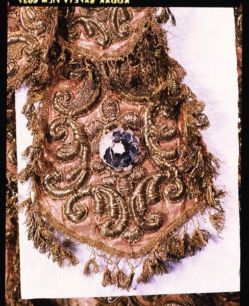 Italy. This costume is a rare surviving 18th century costume made specially for the stage, based on Roman military dress, the breastplates and strip-kilted skirt of the uniforms becoming formalised and the chasing becoming gold padded embroidery. The underlying hessian, which gives substance and structure, and the cardboard-backed glass 'jewels' are in stark contrast to the expensive velvets and metal thread embroidery, braids and fringing which make up the body of the costume.