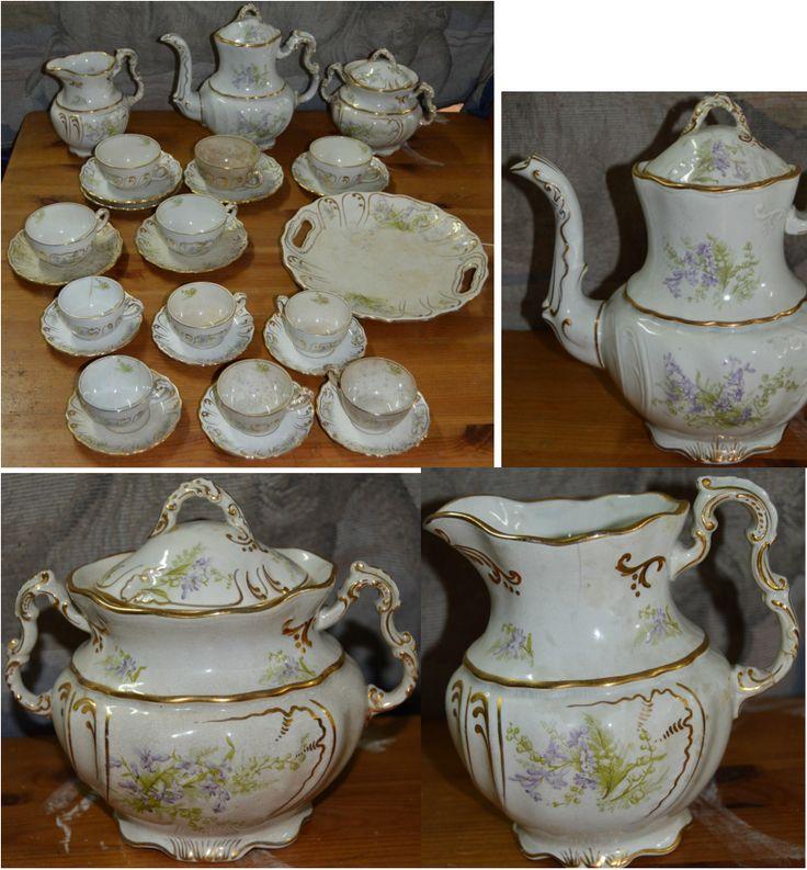 Serviço de chá de Alcantara de 1897, marca gravada na pasta Lopes & Cia, Alcantara.   Composto por bule, leiteira , açucareiro, 5 chávenas de chá, 6 pires de chá, 6 chávenas de café   com pires e prato de bolo. Peças muito bonitas relevadas, enriquecidas a ouro.
