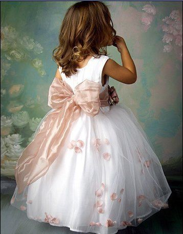 Pick your color flower girl dress with a pink sash and flowers. A silk dress for a wedding ceremony. Junior bridesmaid dresses