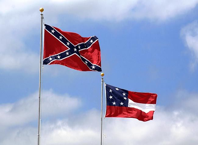 Battle Flag of Northern Virginia (Left), and the First Confederate National Flag (Right)...  With the controversy abounding over the Confederate Flag, we thought it would be appropriate to include this brief history on the origin and evolution of the flag.