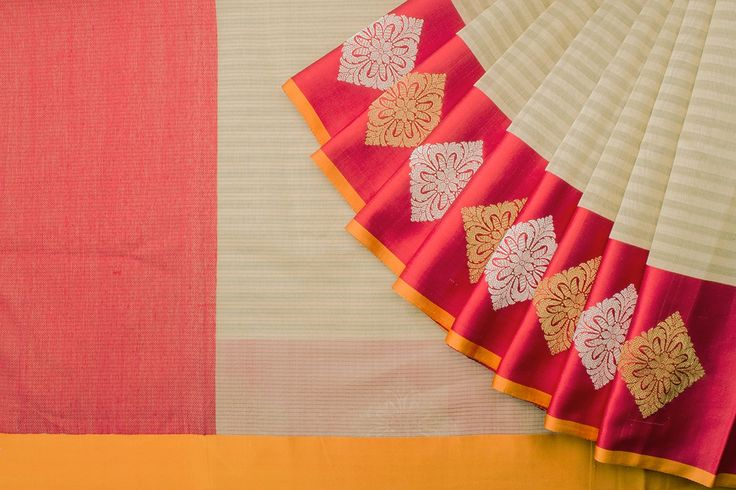 Handwoven Silk Cotton Benarasi sari in a beige colored body with red colored silk borders.