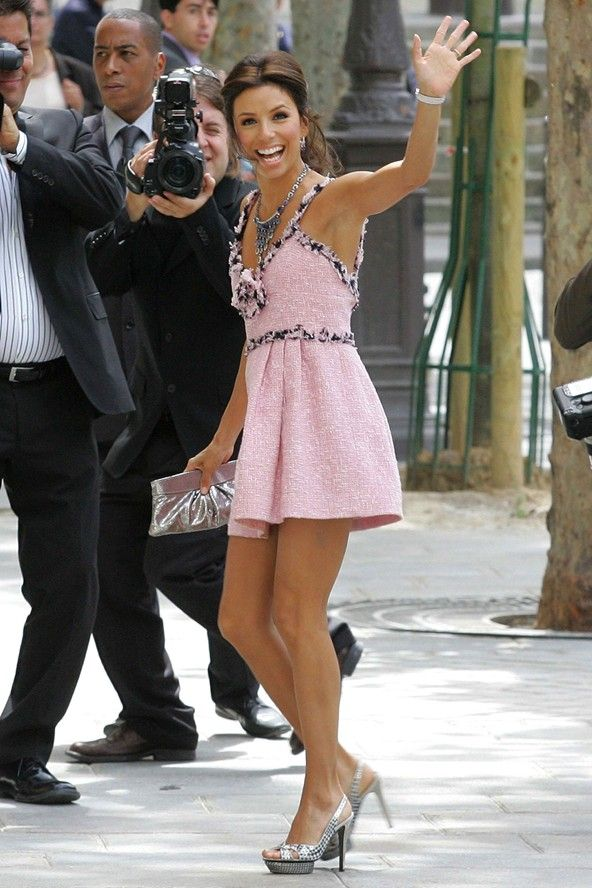 Eva Longoria had 2 weddings with now ex-husband Tony Parker.  The Desperate Housewives star wore a pink Chanel mini dress and silver slingbacks for the first, civil ceremony in Paris, then an Angel Sanchez couture gown for the religious ceremony.