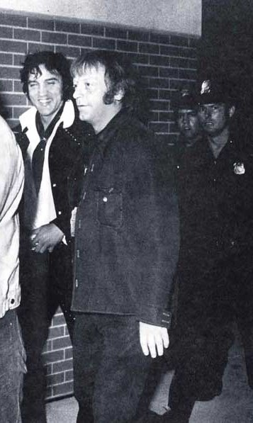 Elvis, and Red West (security) at the Memphis South Men's football opener on July 10, 1974.