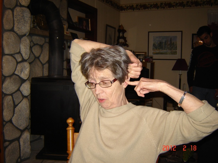 My Mother demonstrating how she has to be a contortionist to put in her hearing aide. lol to bad she doesn't wear it