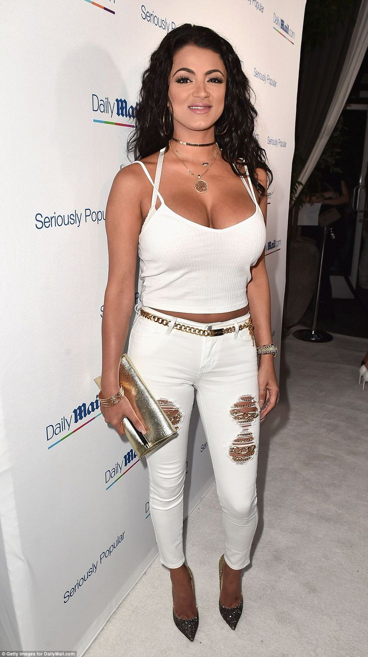 Changing it up: Golnesa 'GG' Gharachedaghi from the Shahs Of Sunset joined the who's who of reality stars at the event wearing distressed white jeans with gold chains and gold sparkly pumps