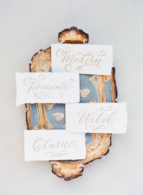 Vintage Blue and Gold Tray with Calligraphy Signs | Vasia Photography | https://heyweddinglady.com/dreamy-blue-latte-wedding-palette/