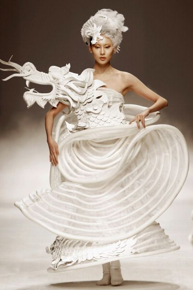 Some of the beautiful imagery of amazing designs on show from the XuMing Haute Couture show during China Fashion Week spring / summer 2013