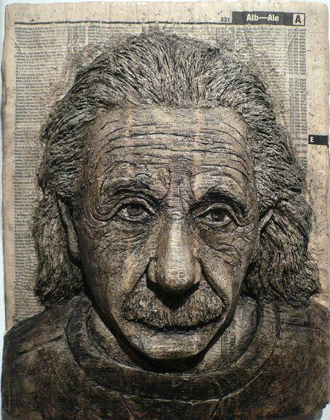 Alex Queral carves portraits of famous people into phone books.  Why didn't I think of that?  Einstein is my favorite.