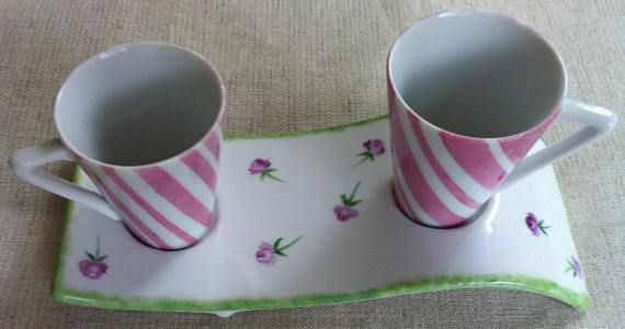Two coffee cups Limoges porcelain with pink stripes on a porcelain stand decorated with small pink roses. The stand is not flat: it forms a sort of wave.  Single model, signed Limoges porcelain fired at high temperature > 800 ° C so dishwasher and microwave  Size: medium: 19cm x