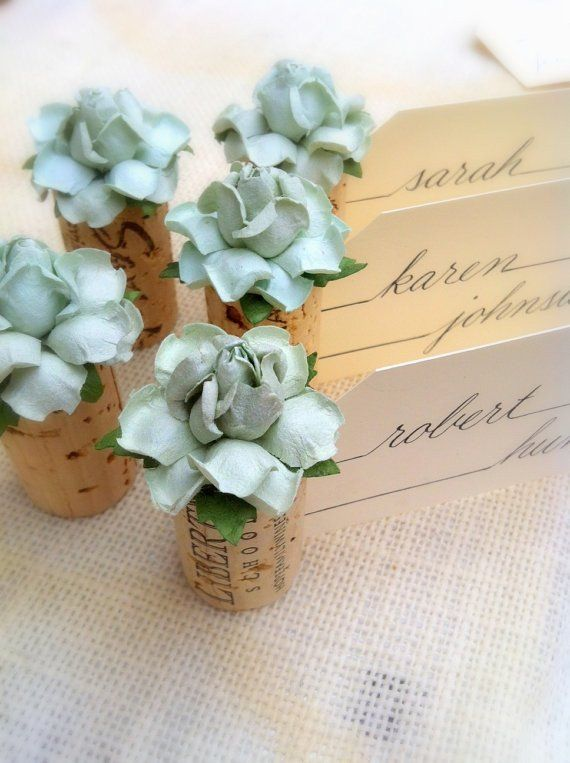"Rustic wedding style with a gorgeous twist! Our Single Cork Succulent Bloom Place Card Holders start with a hand-selected, vintage wine cork. A handmade Succulent Bloom flower is carefully ""planted"" o"