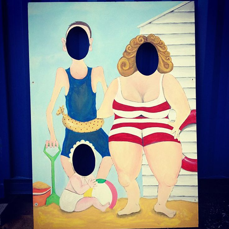 A classic humorous seaside photo wall. A family at the beach in bathing costumes. Pop your face in the hole to complete the picture of a family. Hand painted and varnished with a slight sepia varnish and authentically aged this could be an illustration from the 1920s.