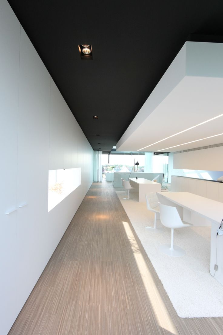 White office area with black ceiling at Luxhome. | OFFICES | Pinterest |  White office and Ceilings