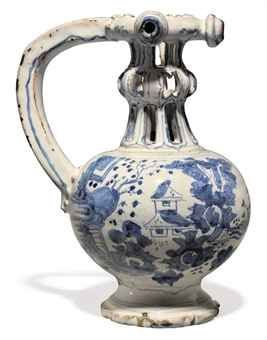 An English Delft blue and white chinoiserie puzzle-jug. Third quarter of the 17th century, London or perhaps Brislington