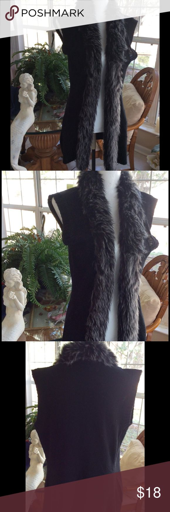 "Cardigan sweater vest Rue 21 Long black sweater cardigan vest with faux fur collar.  Measurements are shoulder 19"", armpit to armpit is 21"", length is 31.5"".  Super cute. Rue21 Sweaters Cardigans"