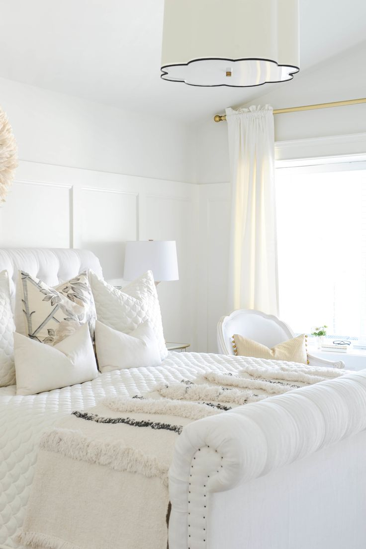 Bright white bedroom and other tips for getting Spring Ready on #SMPLiving!  Photography: Tracey Ayton - traceyaytonphotography.com  Read More: http://www.stylemepretty.com/living/2014/03/24/the-doctors-closet-home-tour/