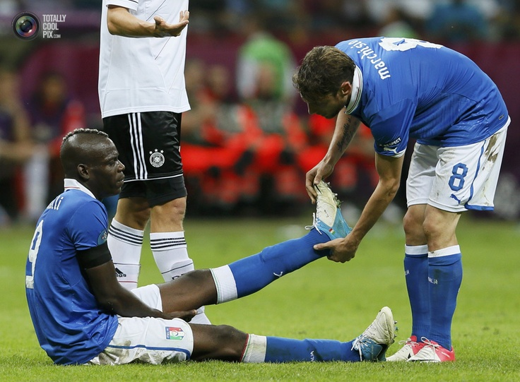 Italy's Marchisio checks the leg of Balotelli during their Euro 2012 semi-final soccer match against Germany at the National Stadium in Warsaw. PASCAL LAUENER/REUTERS
