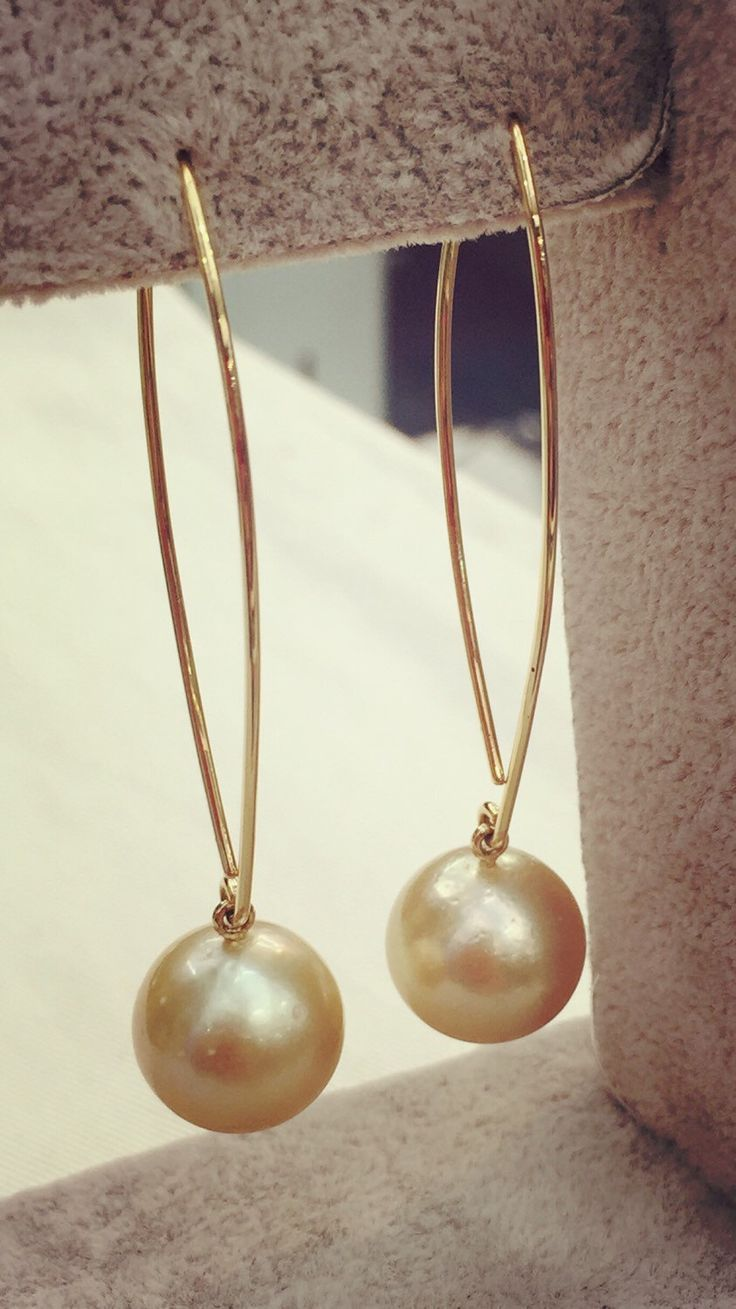 A personal favourite from my Etsy shop https://www.etsy.com/au/listing/246255583/yellow-gold-pearl-hook-earring