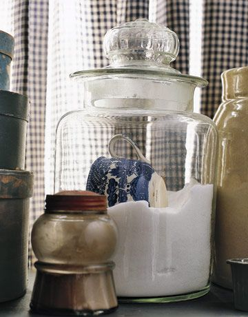 Like the Blue Willow cup in the container..........LOVE the black and white check curtains............