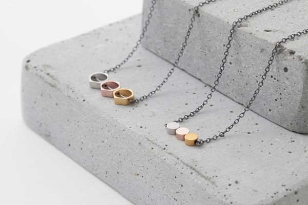 Oxidized silver necklace with three dainty circle beads plated with matte silver, rose gold and matte gold. The necklace has a timeless design, yet stands out with the mixed metals combination.