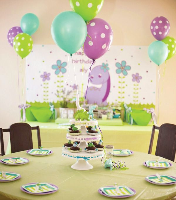Girly Dinosaur Birthday Party: Painted dinosaur figurines used as place card holders