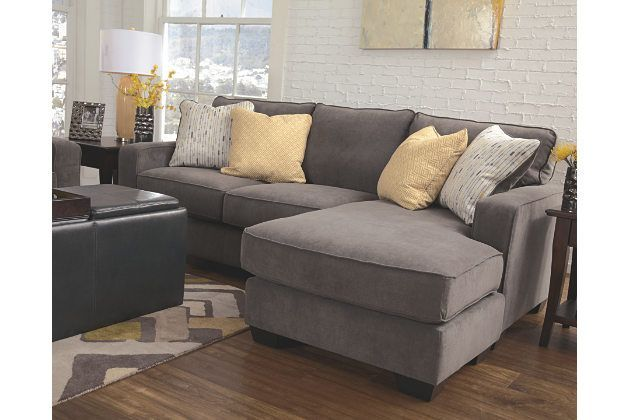 Sometimes clean and simple is simply beautiful to behold. That's the case with the Hodan sofa chaise. It's contemporary—yet warm and inviting—in a soft, earthy shade with plush nap upholstery. Speaking of naps, lay back and enjoy the chaise. With a moveable ottoman-style base and reversible seat cushion, you can have it on the right or the left.