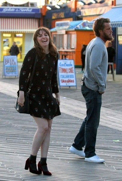 Lena Dunham and Travis Fimmel hold hands as they shoot a romantic scene for an untitled short film project in Brooklyn, New York's Coney Island Boardwalk on April 14, 2017.
