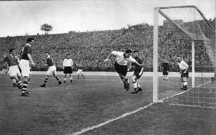 25th September 1954. With Sunderland goalkeeper Willie Fraser beaten full back Joe MacDonald desperately tries to stop a shot from Charlton Athletic centre forward Eddie Firmani hitting the back of the net, at the Valley.