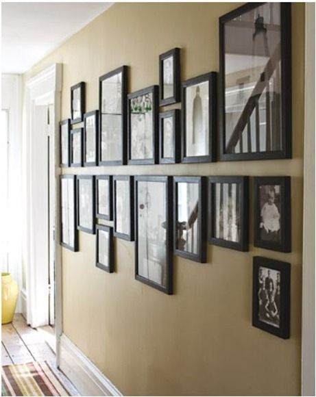 In a hallway, Martha has an interesting take on near reflective symmetry – here the photographs share black frames in different sizes. Despite their variation in size, the balance is achieved by the continual rotation from large to small in reverse and the fact the frames are positioned off of one straight center line.
