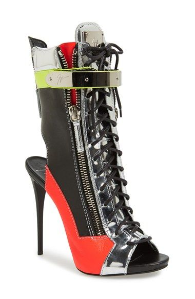 Holy Bad Ass!!! {Giuseppe Zanotti 'Sport' Peep Toe Bootie}--- Pops of mirrored metallic and fluorescent neon leather make a daring, of-the-moment statement on a sky-high stiletto peep-toe bootie with laces, zippers and a plated mirror for good measure.