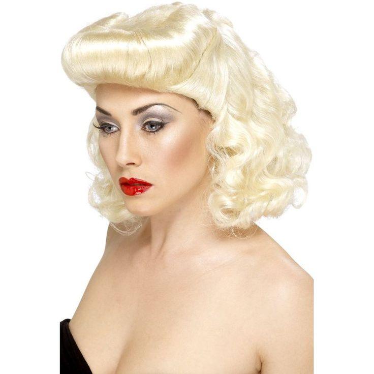 Cette perruque blonde reprend la coiffure des pin up des années 50! Elle sera parfaite pour finaliser votre déguisement sur ce thème des années 50!z