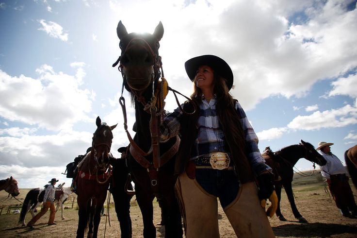 Wrangler Lori Young readies her horse before the start of the horse drive, on May 4, 2012. (Reuters/Jim Urquhart)