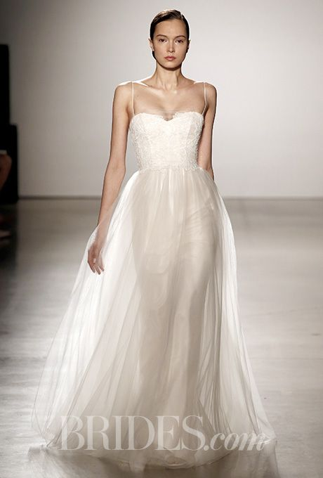A sophisticated @christosbridal wedding dress with a slimming bodice | Brides.com