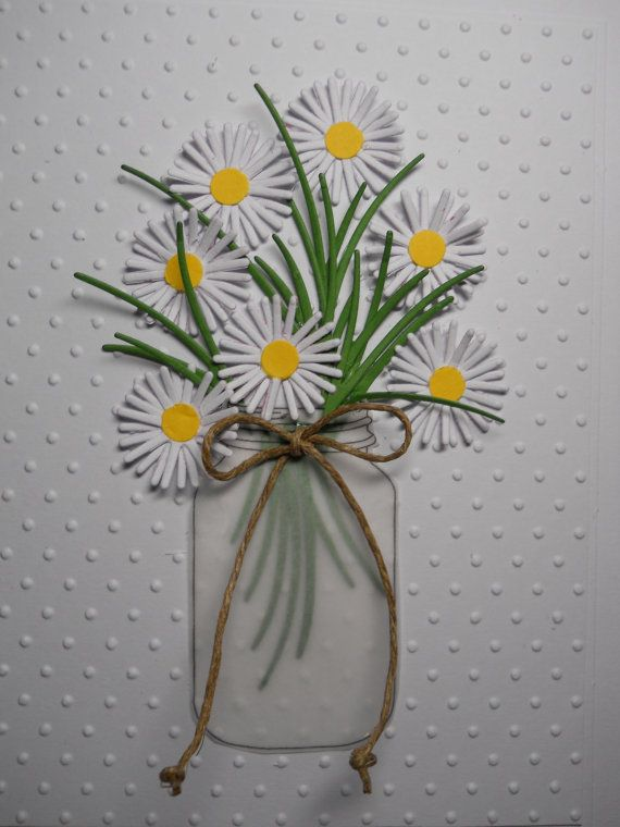 Handmade greeting card for any occasion Mason jar, flowers in a jar, flower bouquet, jar of flowers, country looking flower bouquet Any occasion card: Happy Birthday, thank you, get well, sympathy, country wedding Heavy white card stock Very dimensional Seven smaller daisies die cut in three layers with yellow paper center, and cut from recycled cards White vellum jar with stems showing in jar and tied with jute bow Green wisps of green stems die cut from green recycled cards Embossed swiss…