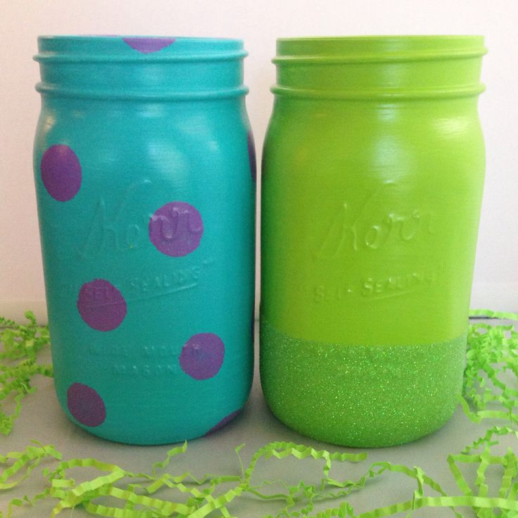 Monsters Inc. themed mason jar vases. Hand painted and glittered. Perfect for a Monsters Inc. party!