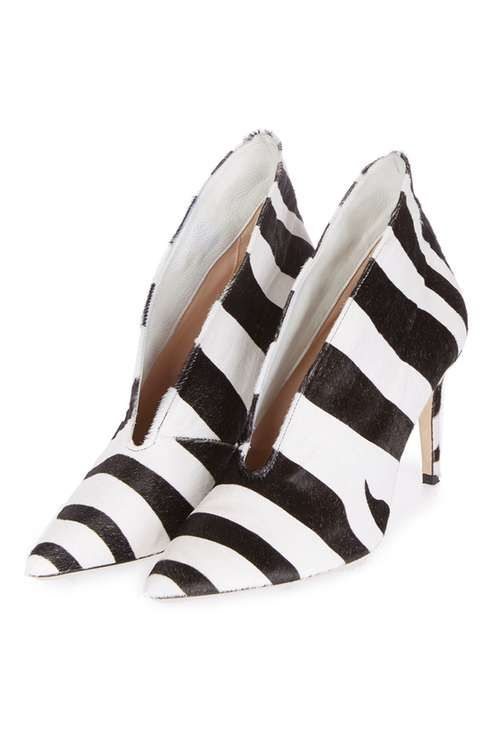 The ultimate 'grown-up' party shoe, these boots by Unique are an iconic addition to the fashion-conscious woman's wardrobe. In a captivating zebra print, they feature a cut-out design to the front and a skinny-mid-heel for comfortable day-to-night wear. #Topshop