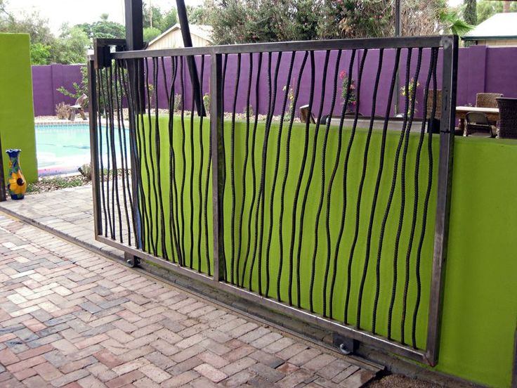 This awesome gate looks like a modern sculpture, yet seems to be made out of humble rebar! Very clever. From Mr G Space Landscape Design. For some great fencing and gate photos and suppliers, visit http://www.landscapingnetwork.com/products/fencing-gates/