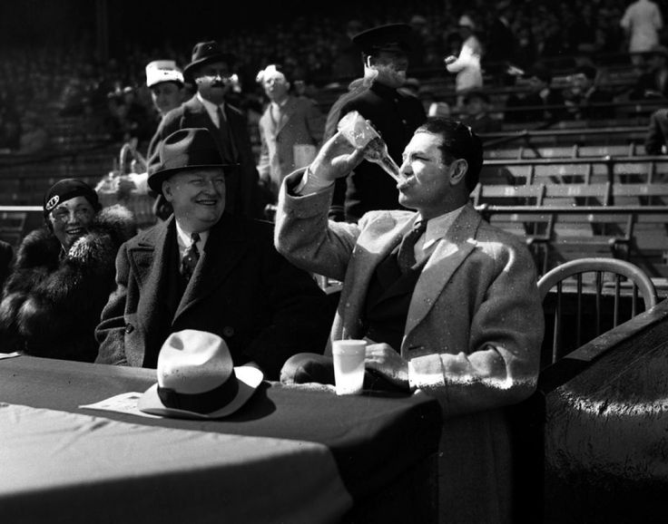 New York Giants founder Tim Mara watches boxer Jack Dempsey drain a bottle of ice cold 3.2 beer at Yankee Stadium in 1933. That's why he's a champ!