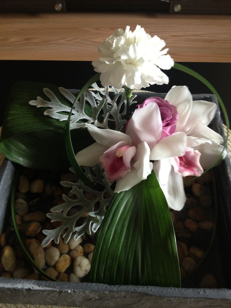 Floral design in a low dish using a pin frog.