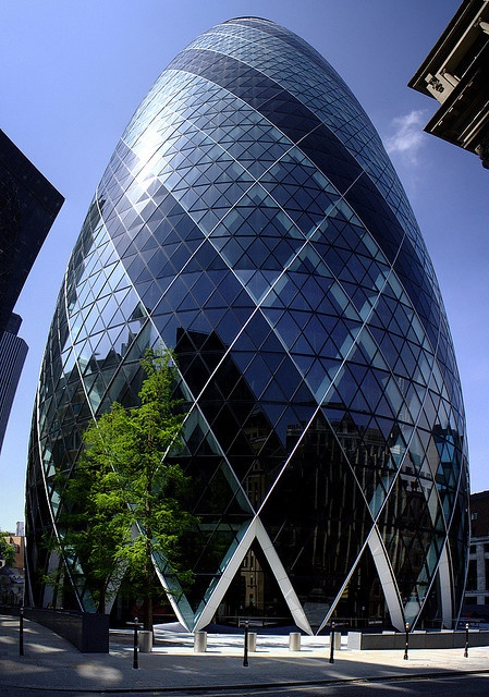 30 St Mary Axe, also known as the Gherkin and the Swiss Re Building, London.  Design: Sir Norman Foster / Foster and Partners  |  Photo by marksteelenz, via Flickr