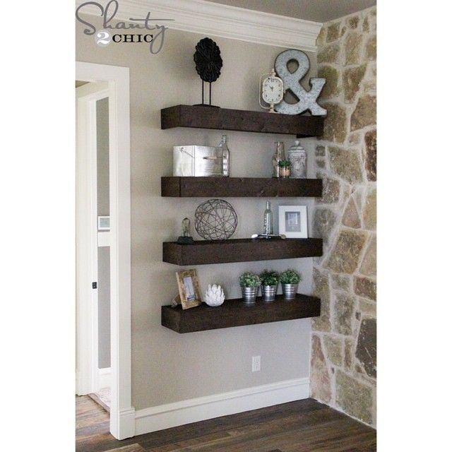 Floating shelves are such an easy and inexpensive way to decorate a space! I built 4 of these 4' long shelves for about $50 - leaving more in the budget for styling! Search 'Floating Shelves' on our site for the free plans! #shanty2chic #alllllltheshelves