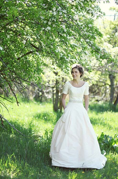 The bride pauses for photos in the springtime sun on the grounds of the McCune Mansion.