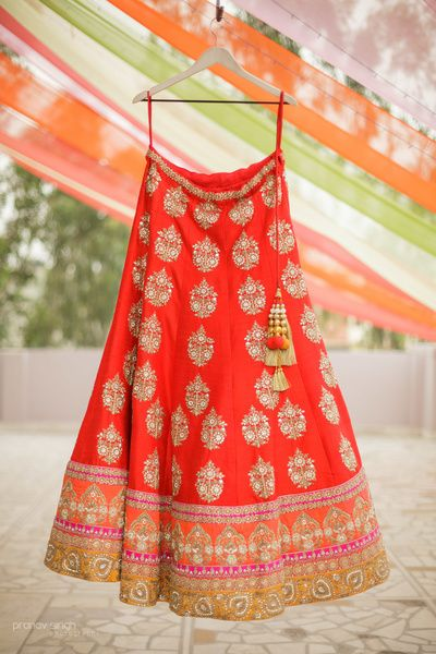 Light Lehengas - Red and  Orange Lehenga | WedMeGood | Red Lehenga with Silver Motifs and Orange and Gold Borders #wedmegood #indianwedding #indianbride #lehenga #indianlehenga #red #lightlehenga