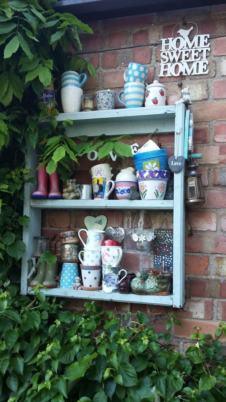 This was recycled from an old seat. Filled with my son's wellies, mugs etc.