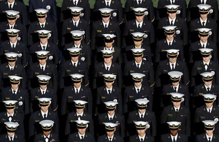 Members of the U.S. Naval Academy stand in formation on the field before an NCAA college football ga... - Patrick Semansky/AP Photo