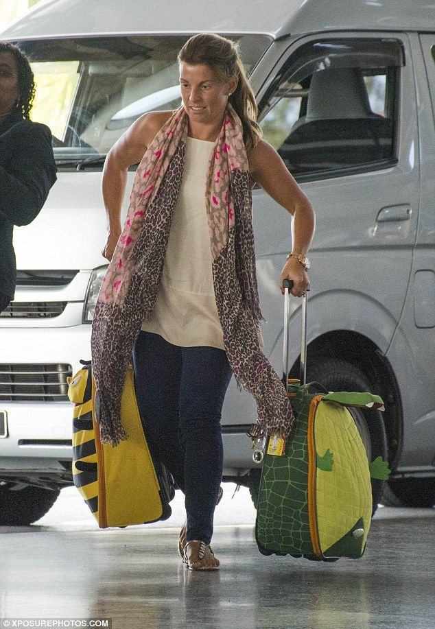 Mum on a mission! The star juggled her children's luggage as she headed into departures...