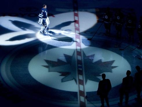 Goalie Ondrej Pavelec skates onto the ice at the start of the Winnipeg Jets'' inaugural game.